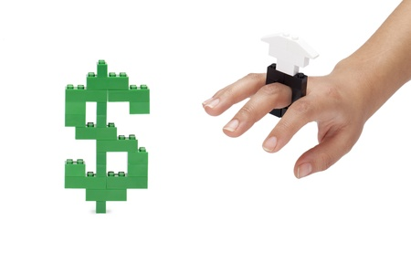 Dollar bill lego getting by the human hand with lego ring Stock Photo - 17150775