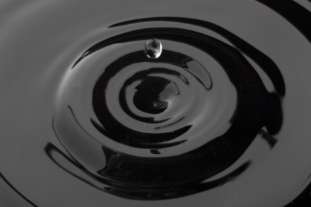 Close up image of falling water drop on black water Stock Photo - 17153680