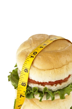 fattening: Closed up shot of burger sandwiches with measuring tape, Fattening concept