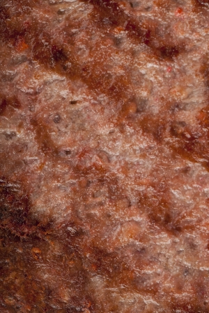 Macro shot of grilled meat patty photo
