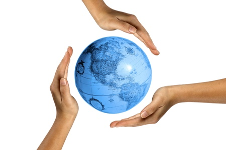 surrounding: Digital image of human hands covering earth.