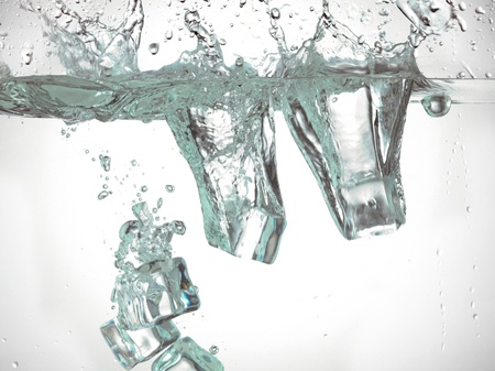 submerging: Ice cubes splashing into the water