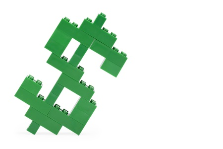 Isolated Dollar Symbol Build Out Of Green Lego Bricks Over A Stock