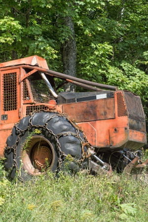 Old logging truck parked on a rural field photo