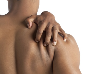 Close-up image of masculine man holding his back in pain against the white surface Stock Photo - 17155098