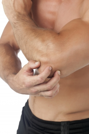 Young man having pain in his elbow Stock Photo Stock Photo - 17155460
