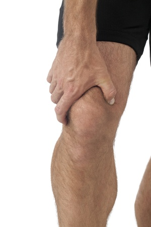 Young man having knee pain in a close-up image Stock Photo - 17152694