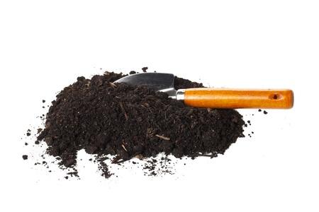 Image of mound of organic soil with garden shovel against white background Stock Photo - 17151823