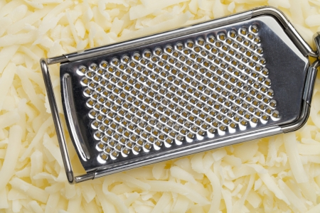 Mozzarella cheese and grater background