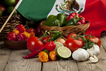 chili peppers: Set of mexican vegetables arranged in table with a mexican flag Stock Photo