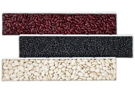 A row of various beans isolated on white Foto de archivo