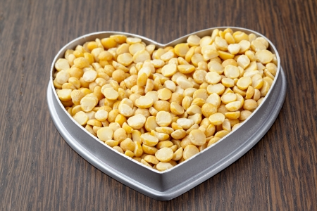 Image of yellow beans on a heart shape container isolated Stock Photo - 17168497
