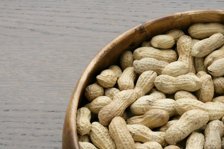 pygmy nuts: Cropped image of a wooden bowl with fresh peanuts