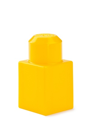 yellow lego block: Close-up shot of a piece of yellow lego block on a white background