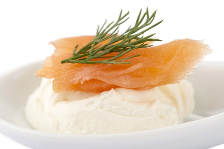 dill leaves: Close-up image of a plate of smoked salmon and cream cheese top with dill leaves