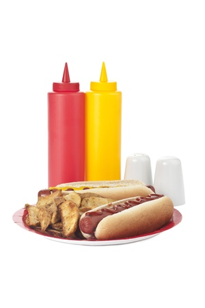 Image of a plate with hotdog sandwiches and potato wedges with condiments on the side Stock Photo - 17151237
