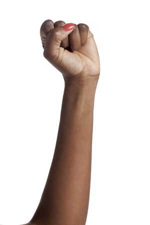 grasp: Close-up image of a womans hand with a clenched fist over the white background Stock Photo