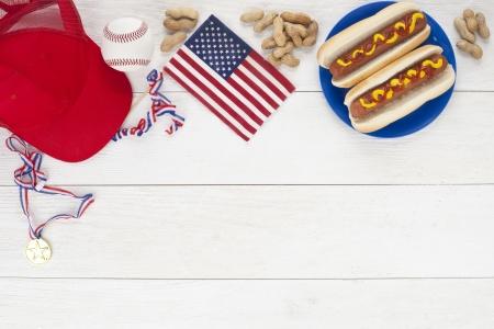 baseball stuff: Image of baseball food and stuff with baseball ball, hotdog sandwiches, medals, peanuts and cap