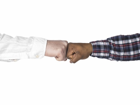 Isolated image of black and white hands doing a fist bump Stock Photo - 17151667