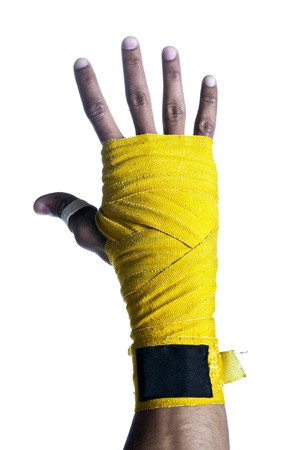 Close-up image of a boxer's hand with yellow bandage isolated on a white surface