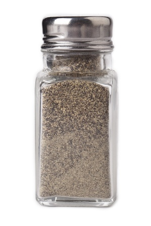 black pepper: Close-up image of a small pepper shaker isolated on a white background