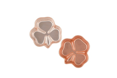 shaped: Two clover shaped ornament made of copper Stock Photo