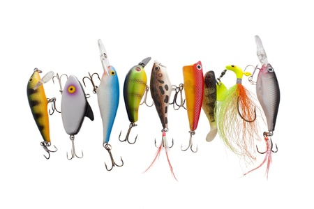 balsa: Close up image of different and colorful fishing lures against white background