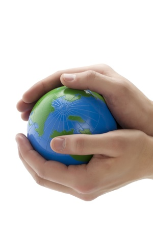 Conserving earth concept image showing hands holding a globe over a white background photo