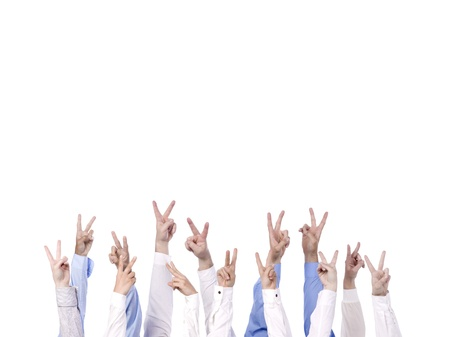 Close up image of different hands gesturing victory sign against white background