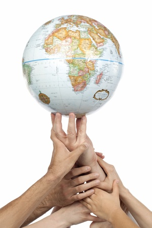 cohesion: Diverse group of hands helping one hand to lift a globe isolated in a white background