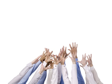 hands raised: Multi-ethnic hands reaching for something against white background Stock Photo