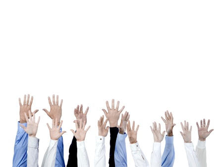 Close up of diverse group of hands raised on a white background