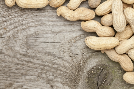 Close up image of dry peanuts on wooden table Stock Photo