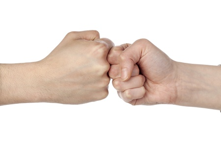 Close up image of fists bump against white background