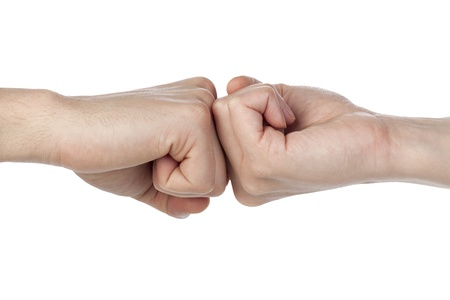 reverse: Two fists with reverse position doing a fist bump