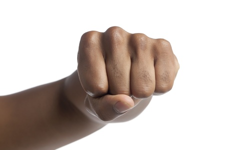 Clenched human fist in a punching gesture photo