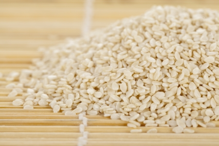 Closed up file of sesame seeds laid on a weave bamboo mat Stock Photo - 17153380
