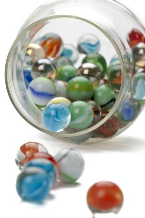 Close-up image of several marbles spilled on the jar isolated on a white background Stock Photo - 17152521