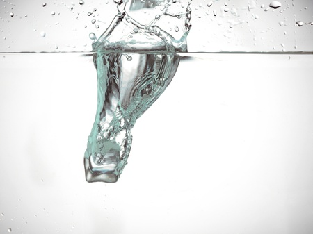 Image of splashing of clear water against the white background