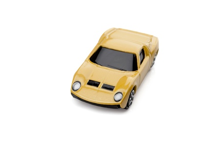 Close-up image of tinted yellow toy car over the white surface Stock Photo - 17150705