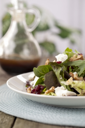 worcestershire: Cropped plate of salad with Worcestershire Sauce bottle at the background