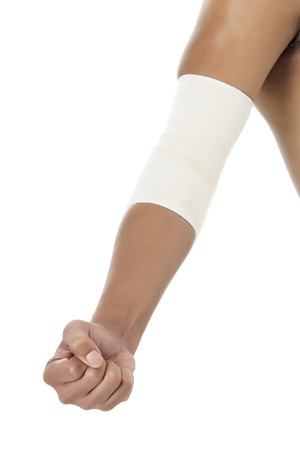 Close-up image of a humans arm with a close fist and a bandage on his elbow photo