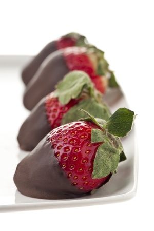 Detailed shot of chocolate dipped strawberries arranged in plate. Stock Photo - 17152374