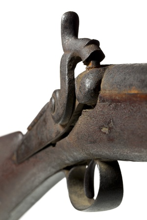 A close-up image of a vintage gun trigger over the white background Stock Photo - 17152511