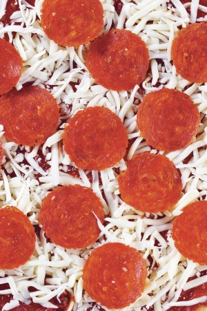 A close-up of pizza toppings over the cheese