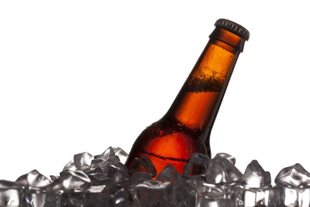 detailed shot: Detailed shot of chilled beer bottle in ice cubes.