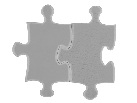 detailed shot: Detailed shot of grey puzzle piece against white background.