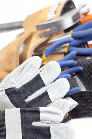 A vertical close-up shot of construction tools and gloves on a white background Stock Photo - 17167539