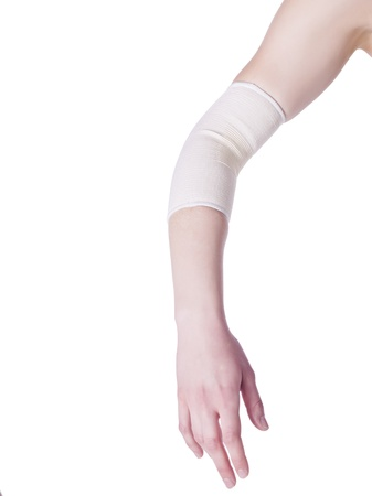 Image of female elbow with bandage against white background Stock Photo - 17150702