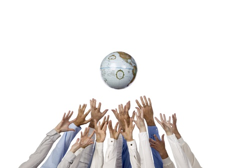 the responsibility: Several different people reaching the globe using their hands Stock Photo